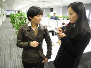 Digital designer You Chunjie explains a point to translator Jessica Li